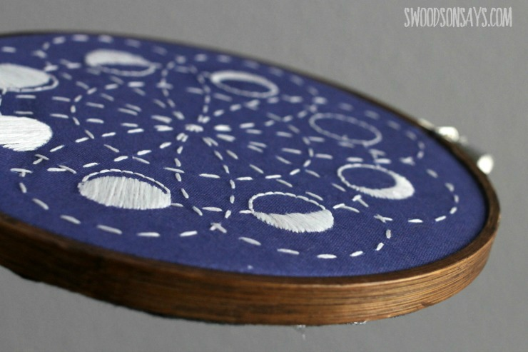 moon phase embroidery with dark stained embroidery hoop