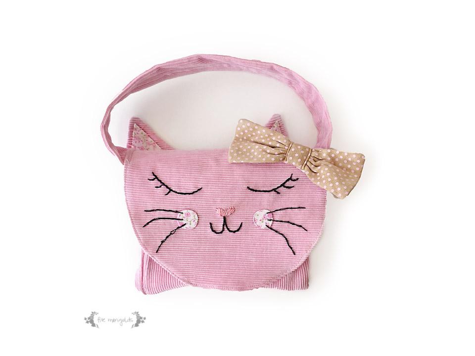 kids clothes into a purse